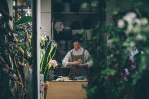 business owner in florist shop